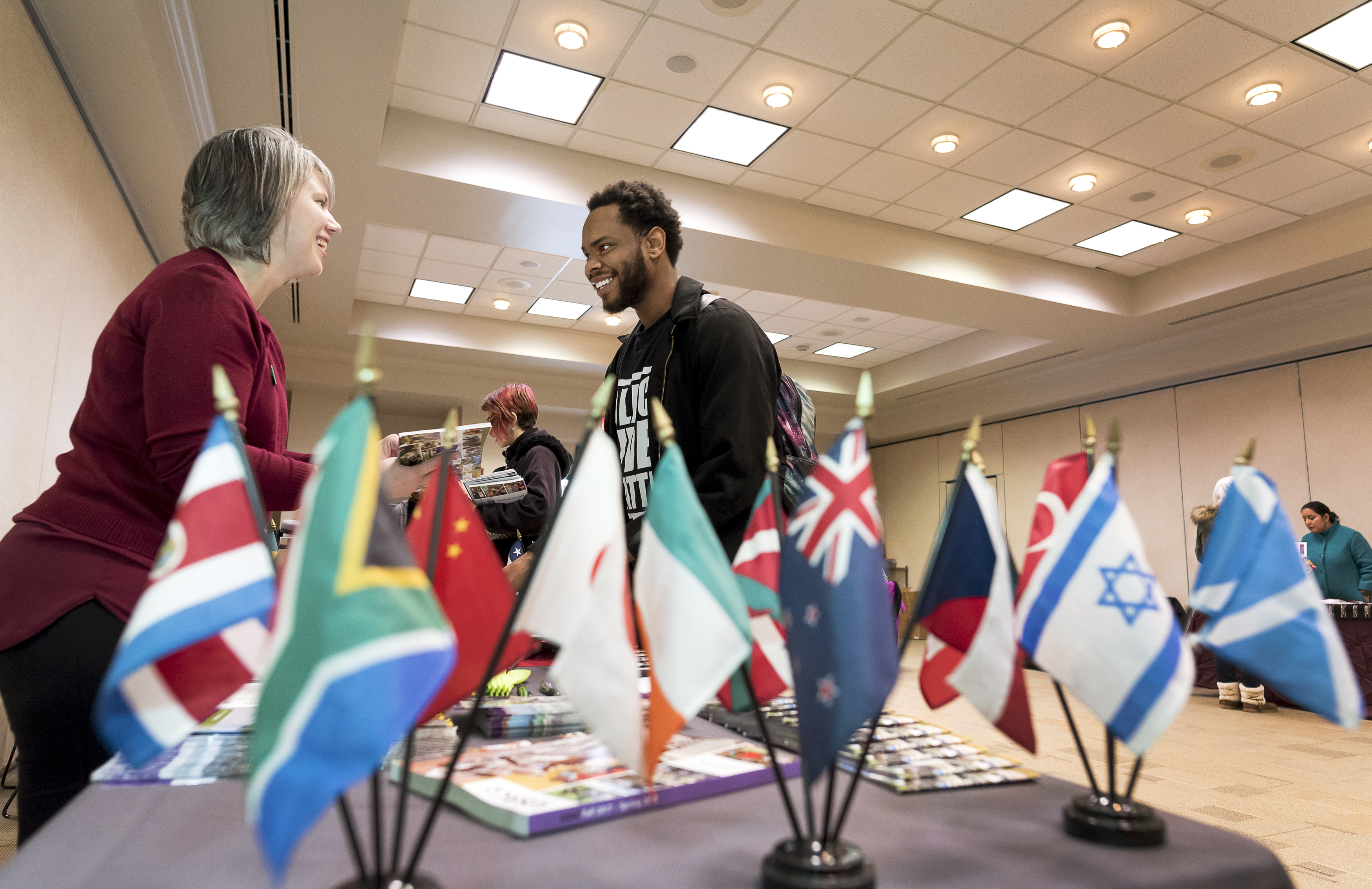 Jaa'lon Baker speaks with Rachel Hardison of the University Studies Abroad Consortium during Study Abroad Day in the DSC on February 15, 2017.