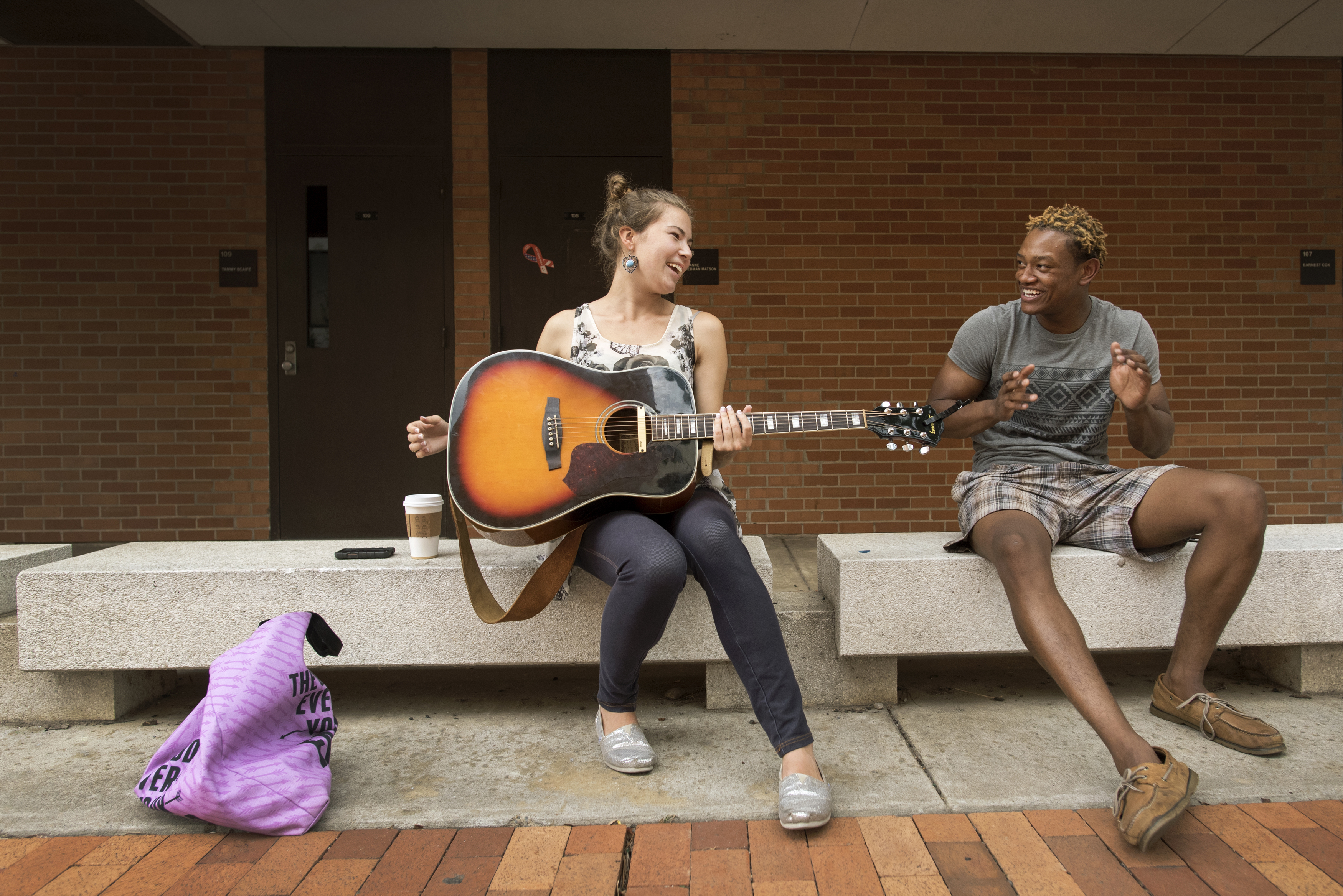Students play guitar and sing near the Old Student Union on September 16, 2015.