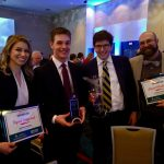 Ingrid Helgested, Noah Asher, Nick Lester, and their faculty advisor Stuart McLendon take first place in the undergraduate division of the Governor's Cup competition.