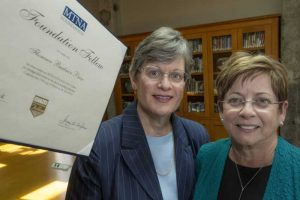 Linda Holzer (left) donates a certificate honoring Florence Price as a Music Teachers National Association Foundation Fellow Award recipient to Deborah Baldwin (right) at the Center for Arkansas History and Culture. Photo by Ben Krain.