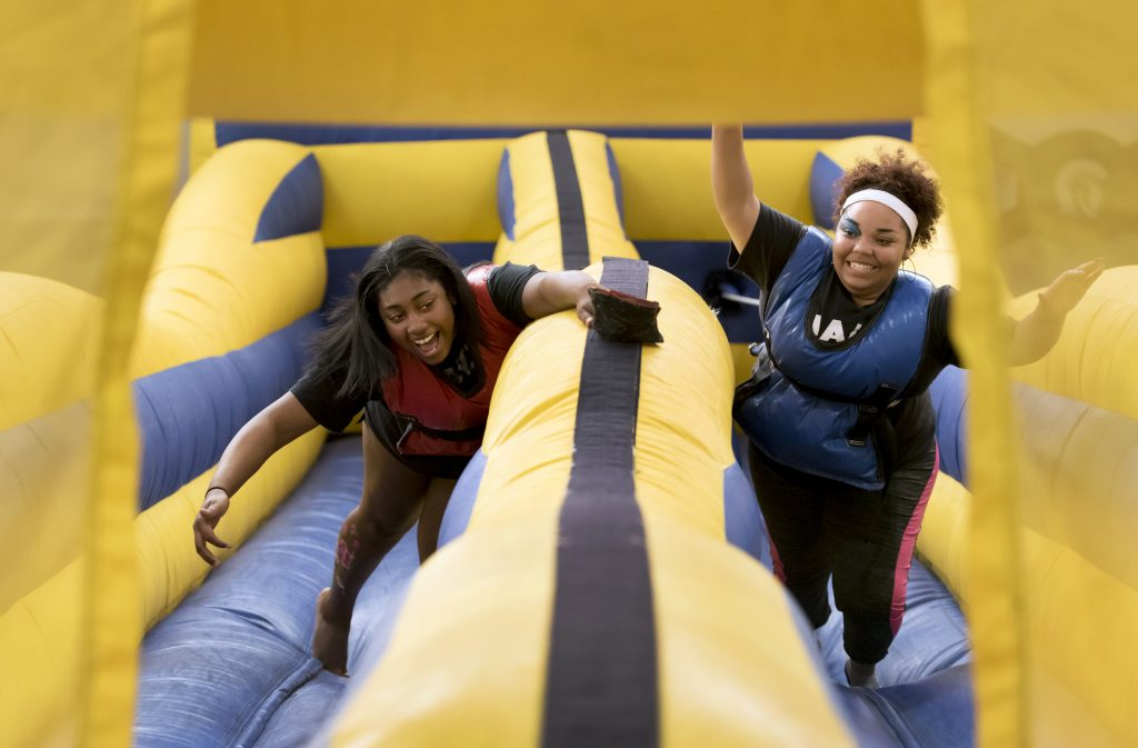 Students Arania Underwood and Khadijah Muhammad play bungie-run on October 27, 2016