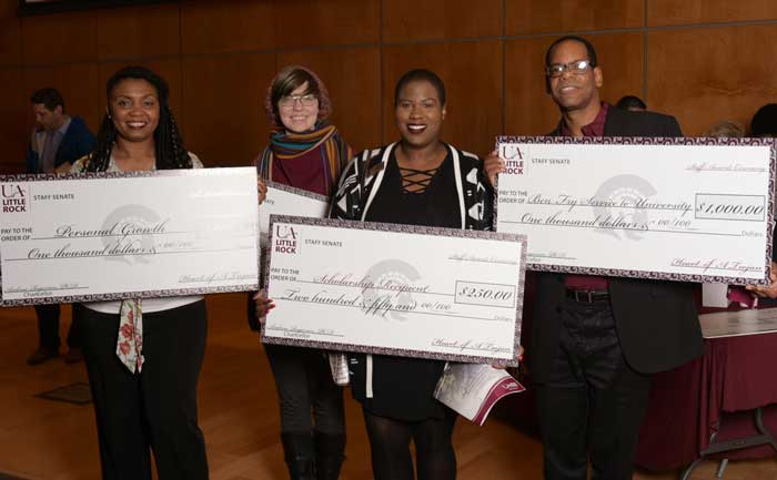 Pamala Stanley, winner of Personal Growth Award, Celeste Watson, Crittenden Book Scholarship recipient, Tierra Hutley, Staff Senate Scholarship winner, and William Wagner, winner of Ben Fry Service to UA Little Rock Award. Photo by Ben Krain.