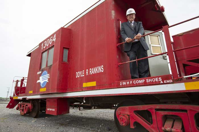 Doyle Rankins stands on the Union Pacific 1960s patio caboose that bears his name. Photo by Ben Krain.