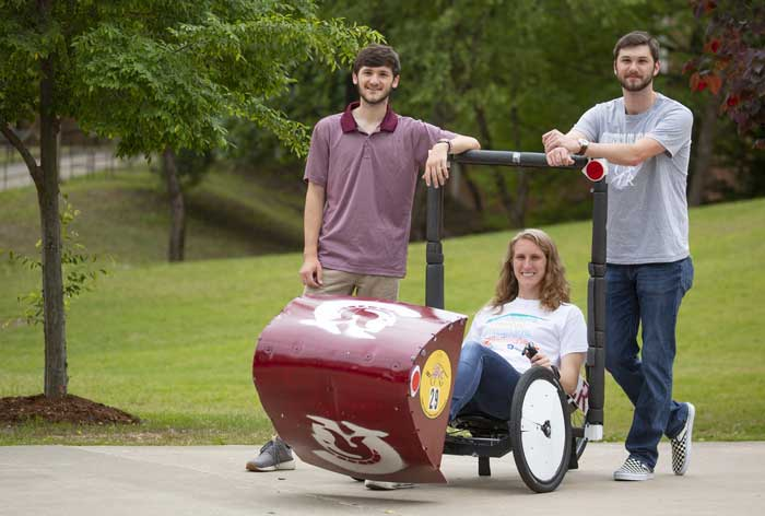UA Little Rock Systems Engineering students Hugh Benfer, left, Jason Reed, right, and Shelby Wingate, middle, competed in the Human Powered Vehicle Challenge in State College, Pennsylvania. Photo by Ben Krain.