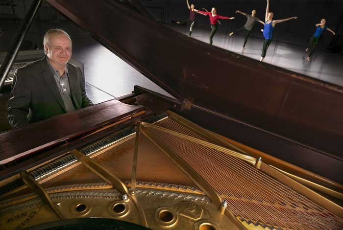 Michael Heaver plays the piano for dance students at UA Little Rock. Photo by Ben Krain.