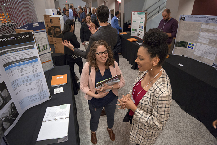 """Photo by BENJAMIN KRAIN -04/12/18-Corrie Green, right, talks about her project """"The New African-American Woman: Exploring Intersectionality in Non-Traditional Casting"""" to Jana McAuliffe who was judging some of the 150 student works at the Student Research and Creative Works Showcase. Green was one of 150 student researchers, artists and entrepreneurs presenting projects at the event."""