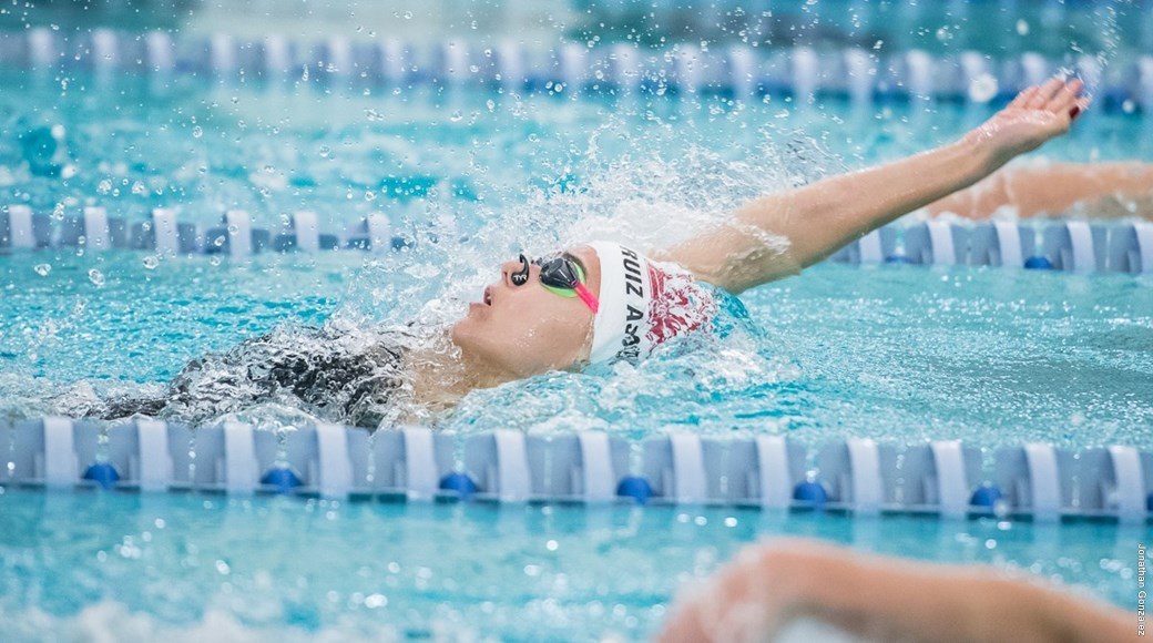 A member of the 2018 swimming and diving team competes.