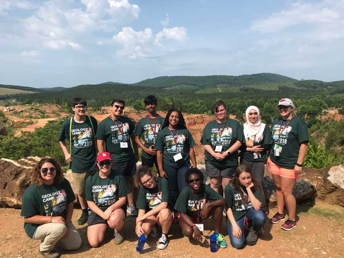 The UA Little Rock Geology Camp participants (L to R) include: Front row: Geology camp instructors Elizabeth Haralson and Calie Pace and students Michelle Jones, Caroline Nalumansi, and Kaitlyn Gill. Back Row: Faizan Parray, Luigi Cutolo, Sreevatsav Seenivasan, Blair King, Jodi Williams, staff member, Insherah Qazi, and Maranda Geoffrion, staff member.