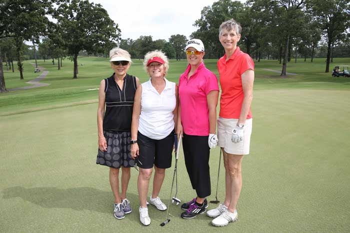 Ellon Cockrill, Beth Mason, Sharon Vogelpohl, and Margaret Ellibee compete at the College of Business Golf Tournament.