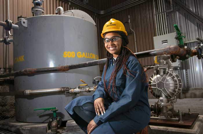 Caleaha Virgil, a 21-year-old senior from Conway, works as an engineering intern at Reynolds Consumer Products in Hot Springs. Reynolds Consumer Products is known for its trusted household products, including Reynolds Wrap foil and Hefty trash bags, slider bags, and disposable tableware. Photo by Ben Krain.