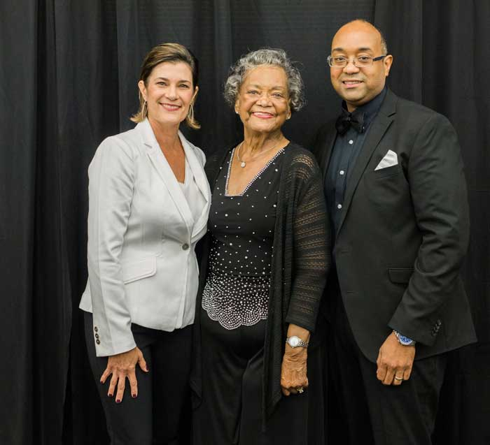 Holly Fish (left), Raye Montague (middle), and David Montague (right) celebrate Raye Montague's induction into the Arkansas Women's hall of Fame.