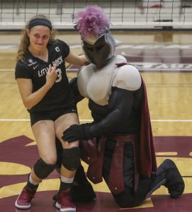 Sydnee Martin poses for a picture with the Trojan mascot shortly he reveals himself as her boyfriend, Jacob Bland. Photo by Ben Krain.
