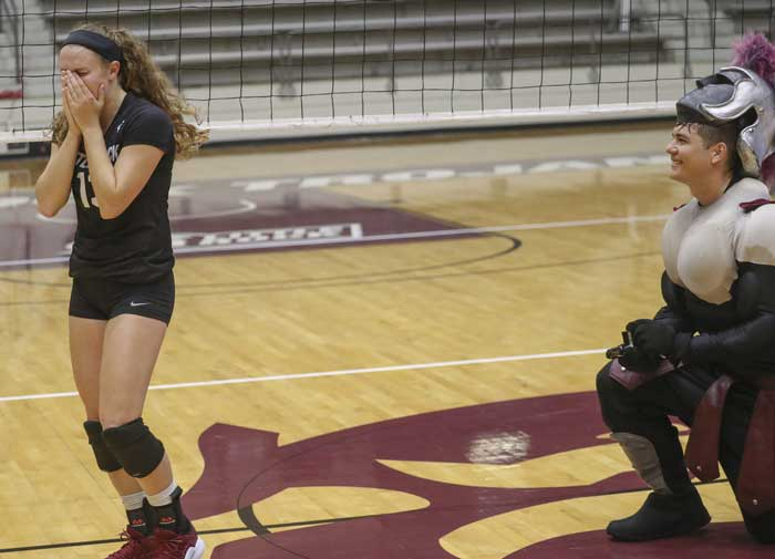Volleyball player Sydnee Martin is shocked as her boyfriend, Jacob Bland, proposes to her after dressing up as the UA Little Rock mascot during her volleyball game on Sept. 21 at Jack Stephens Center.