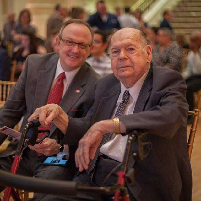 Bruce Trimble (left) celebrates with his father, Robert Trimble, after receiving the UA Little Rock 2018 Alumni Making a Difference Award.