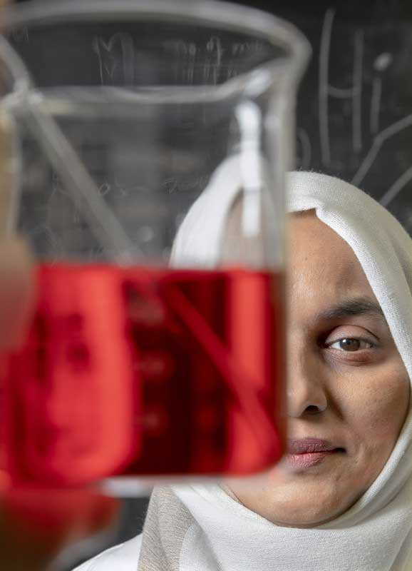 In the upper right photo, Noureen Siraj works in her chemistry lab. Photo by Ben Krain.