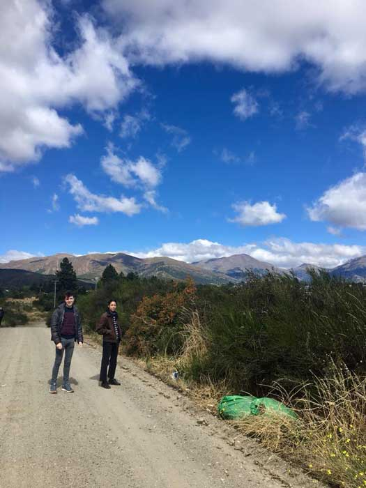 Dylan Wright (left) and a fellow student take a walk near a Mapuche organization's headquarters in Bariloche, Argentina, a largely tourist town known for its Swiss colonial influence.