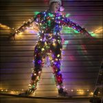 """Shane Johnson is wrapped up in some of the more than 25,000 lights he used in his original holiday lights show, """"Lights on Jupiter."""" Photo by Ben Krain."""