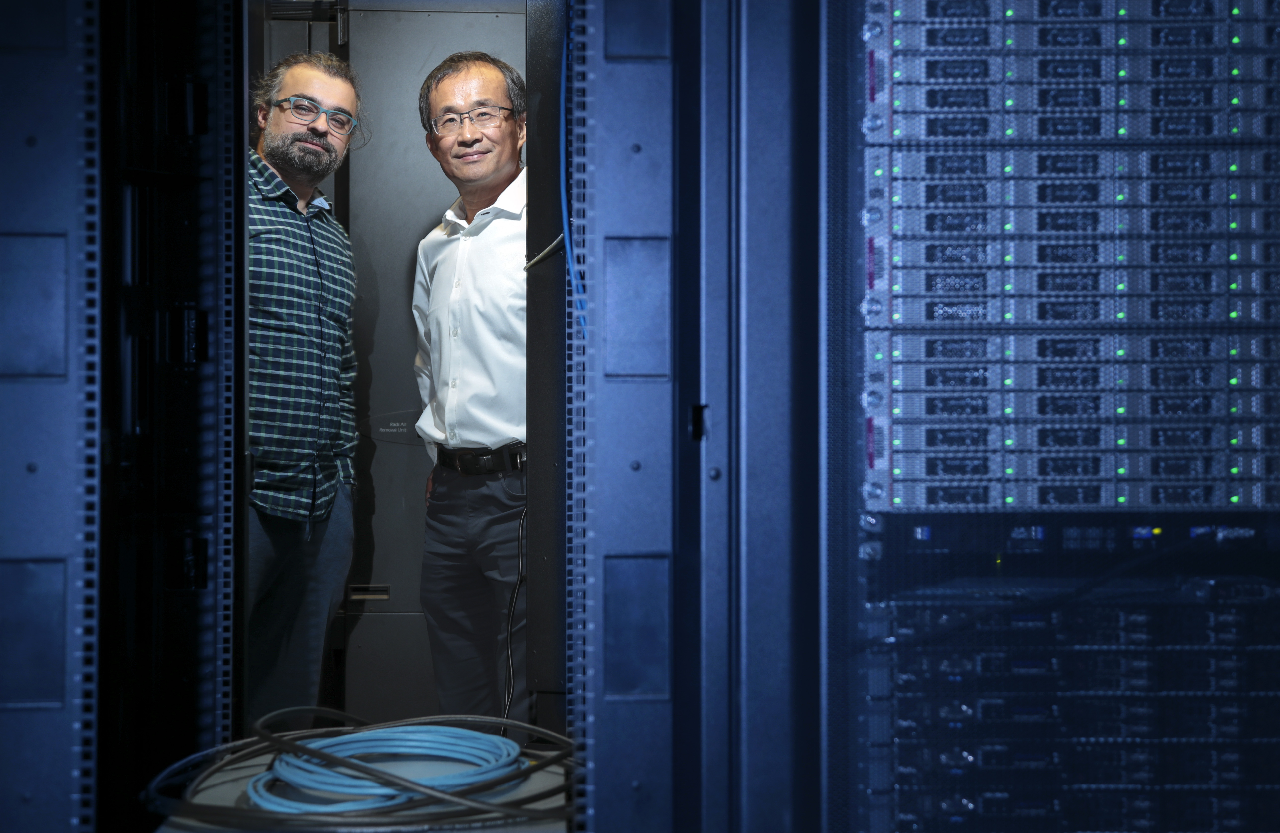 """Tolgahan Cakaloglu (left), a doctoral candidate in computer science, and Dr. Xiaowei Xu (right), professor of information science, received a $20,000 grant from Google for their project, """"Contextual Advanced Text Representation via Improved Deep Language Model by Utilizing Side Information."""" Photo by Ben Krain."""