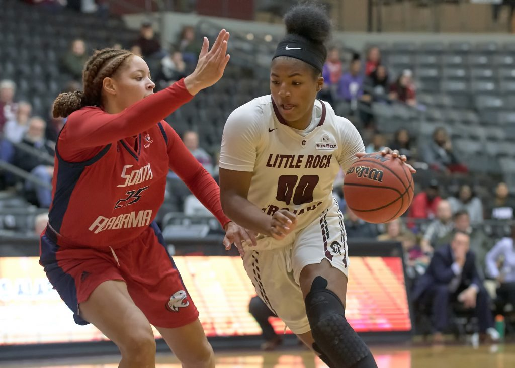 UA Little Rock women's basketball player Ronjanae DeGray (right) battles against South Alabama.