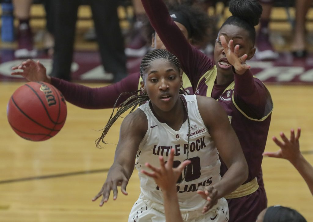 UA Little Rock forward Raeyana DeGray is surrounded by Texas State defenders during the Trojan's game at the Jack Stephens Center. Photo by Benjamin Krain.