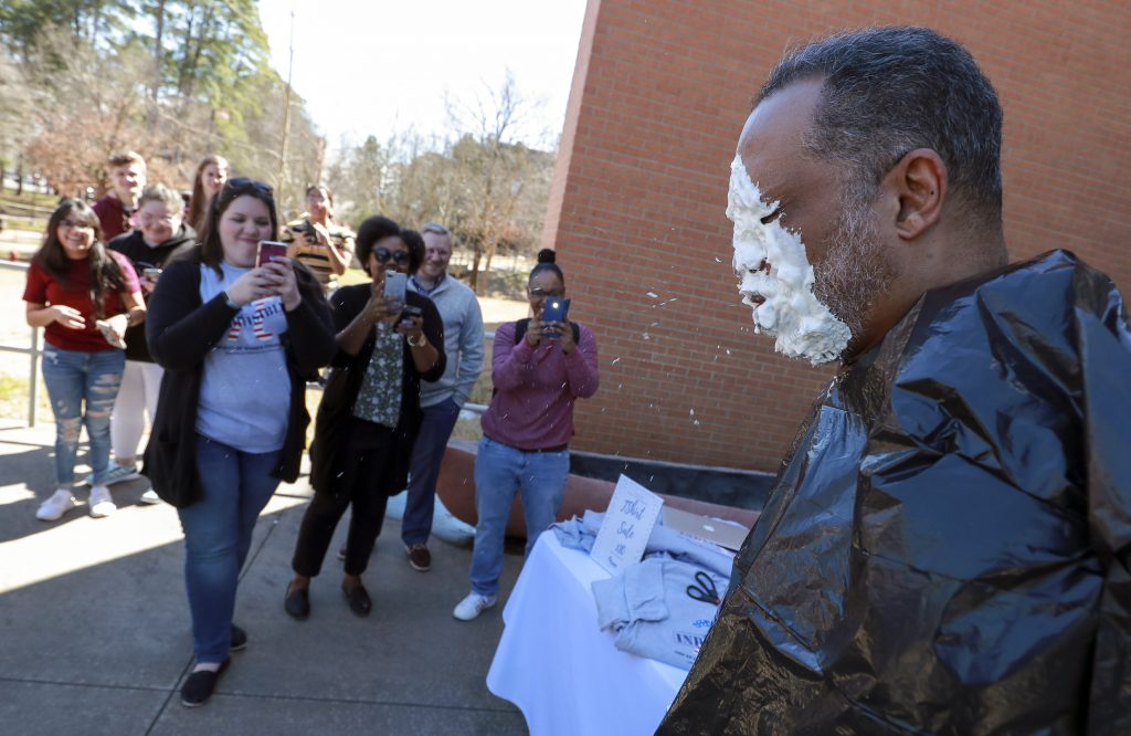 EIT Assistant Dean Vernard Henley takes a pie in the face during a fundraiser for the Society of Women Engineers. Photo by Benjamin Krain.