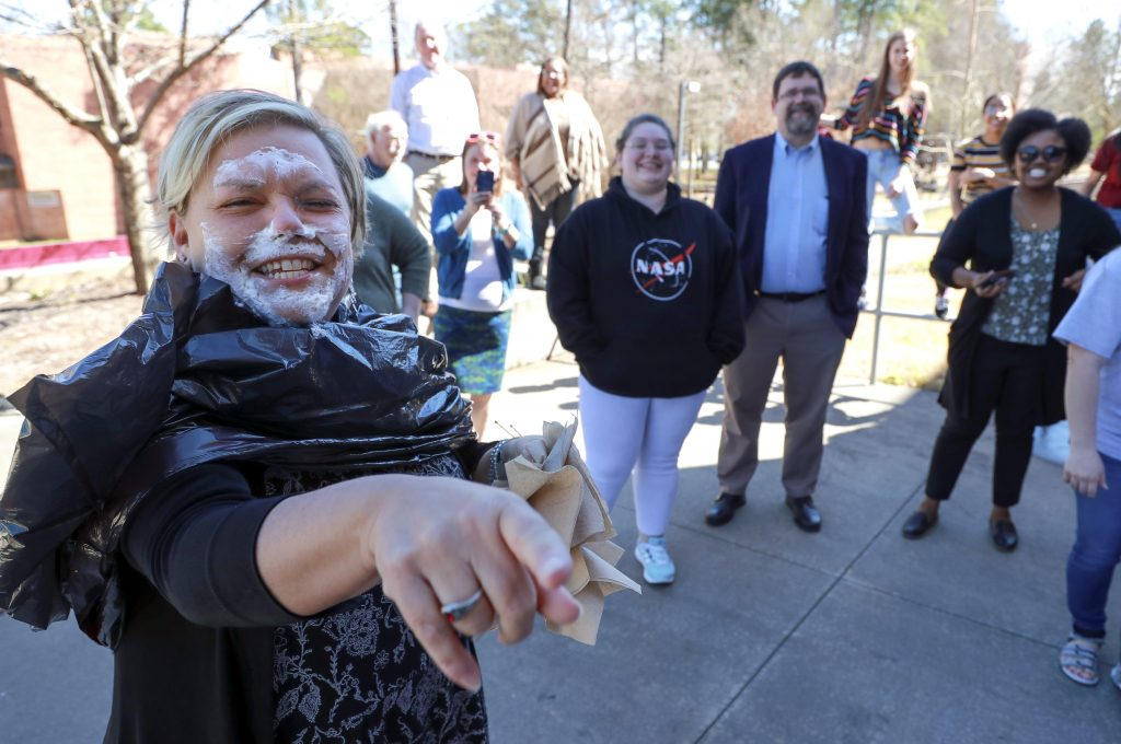 Amy Frets takes a pie in the face during a fundraiser for the Society of Women Engineers. Photo by Benjamin Krain.