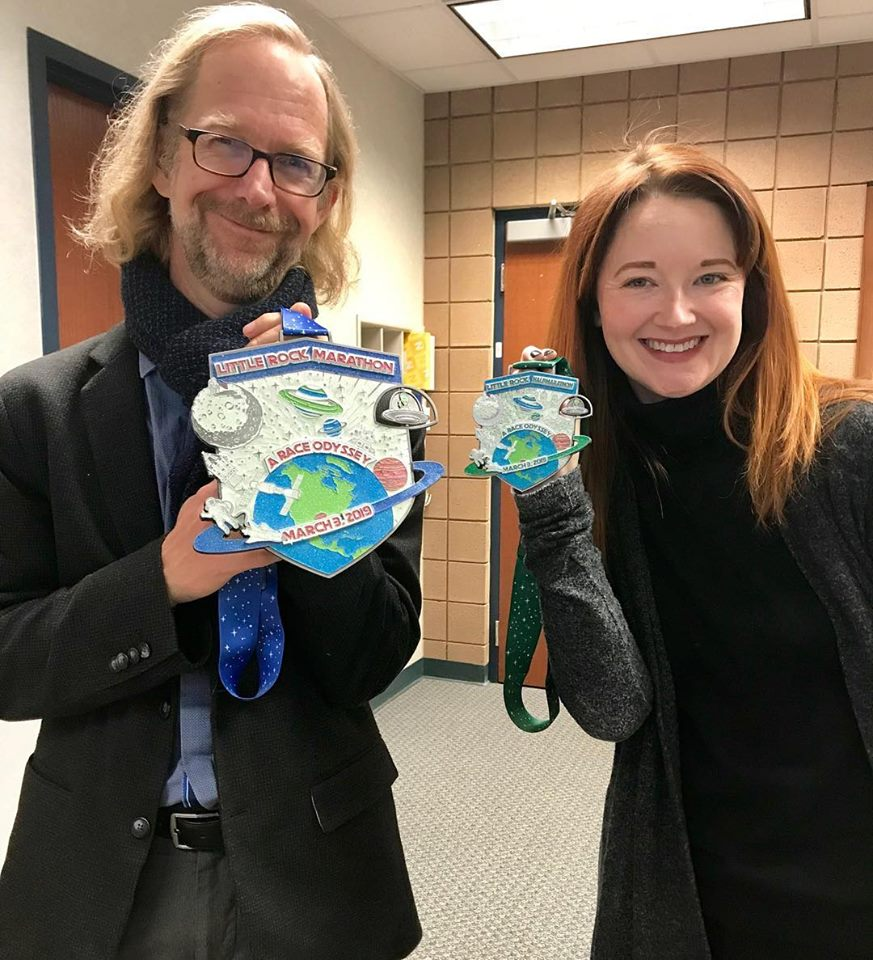 Dr. Simon Hawkins and Dr. Jessica Scott proudly show off their Little Rock Marathon medals.