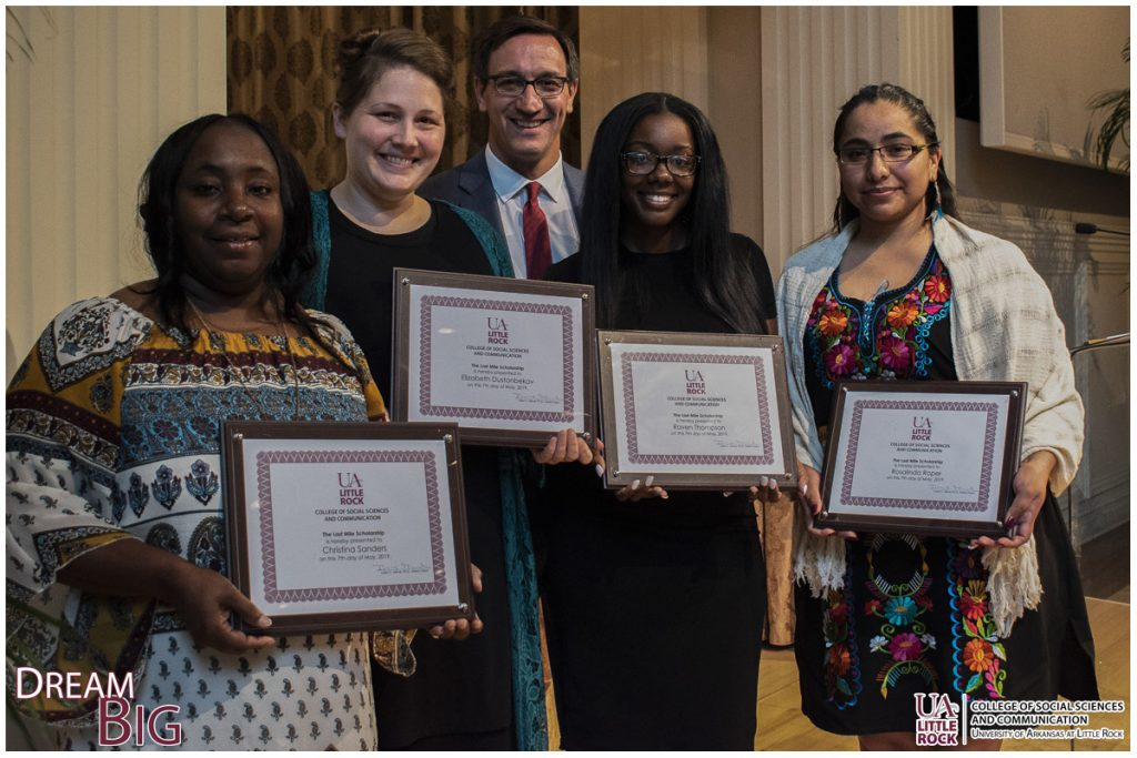 Interim Dean Julien Mirivel, middle, congratulates recipients of the Last Mile Scholarship: Christina Sanders, Elizabeth Dustonbekov, Raven Thompson, and Rosalinda Roper.