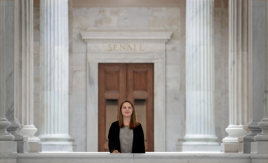 Julia O'Hara, who is graduating from UA Little Rock with a bachelor's degree in political science, stands outside the Senate chambers in the Arkansas State Capitol building. Photo by Ben Krain.