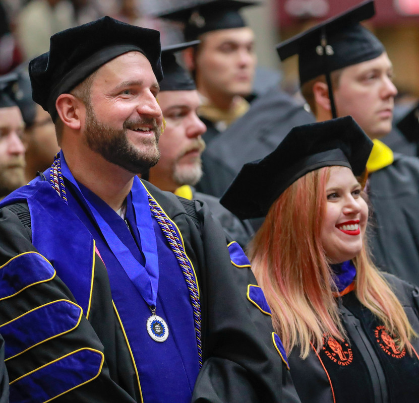 UA Little Rock criminal justice doctoral student Marc Glidden, a visiting assistant professor of criminal justice is hooded during the commencement ceremony on May 11. Photo by Ben Krain.