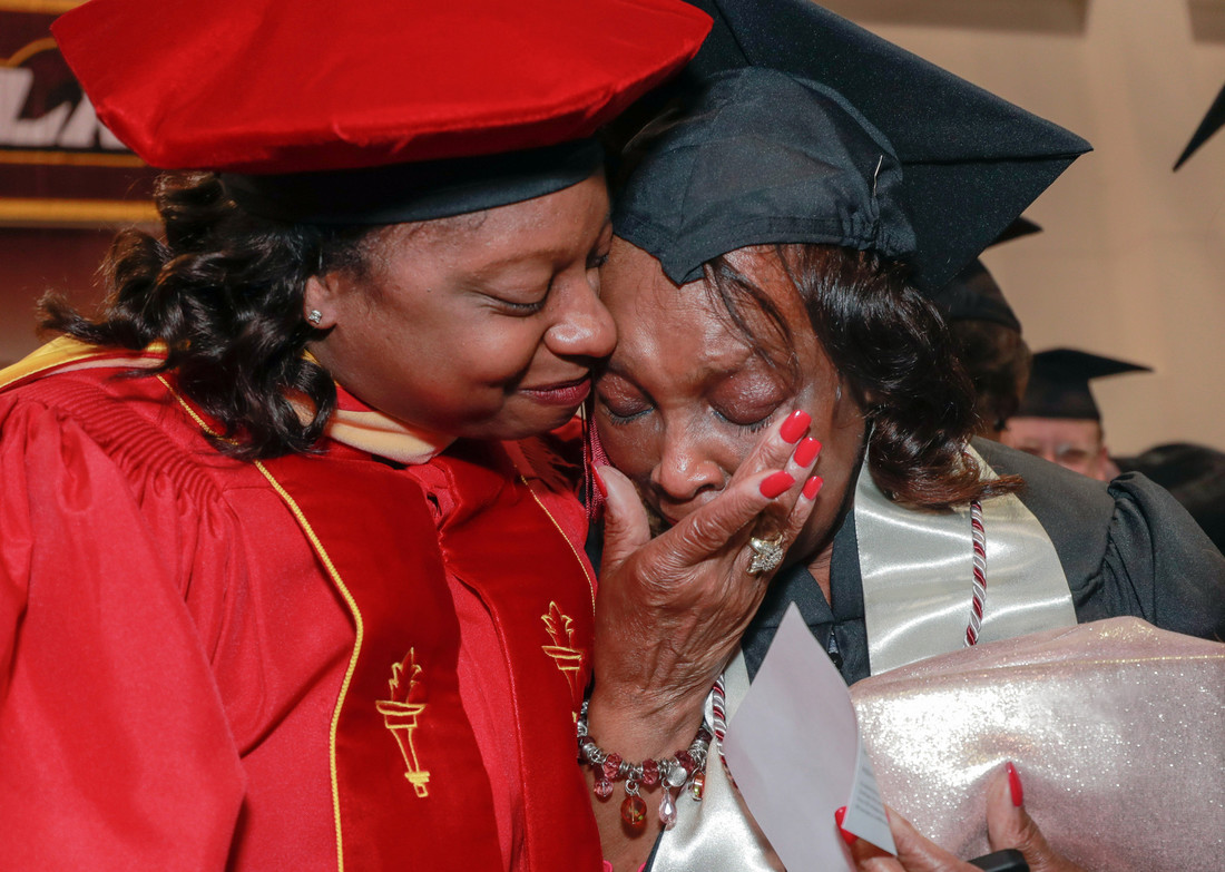 Graduate Vivian Littrell, right, reacts with tears of joy after her niece Chauntee Coleman, left, makes a surprise visit to Littrell;s graduation ceremony at UA Little Rock. Photo by Ben Krain.