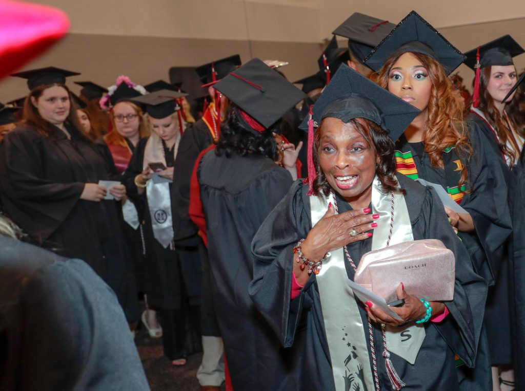 Graduate Vivian Littrell, right, reacts reacts in shock after her niece Chauntee Coleman, off camera at left, makes a surprise visit to Littrell's graduation ceremony at UA Little Rock on May 11. Photo by Ben Krain.