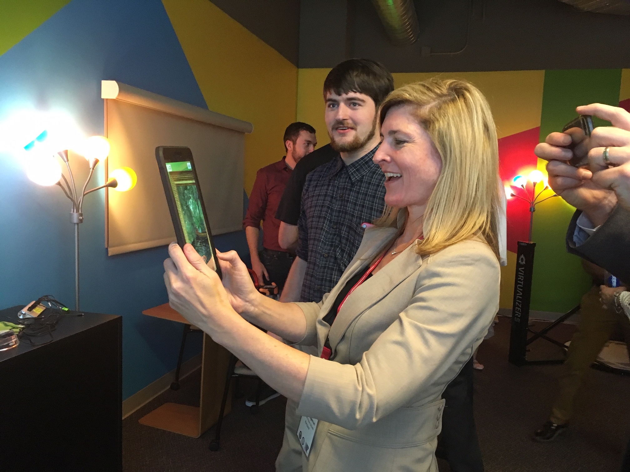 Heather Lageman, a summit participant and executive director of leadership development at Baltimore County Public Schools, uses an educational augmented reality application targeted to art museums.