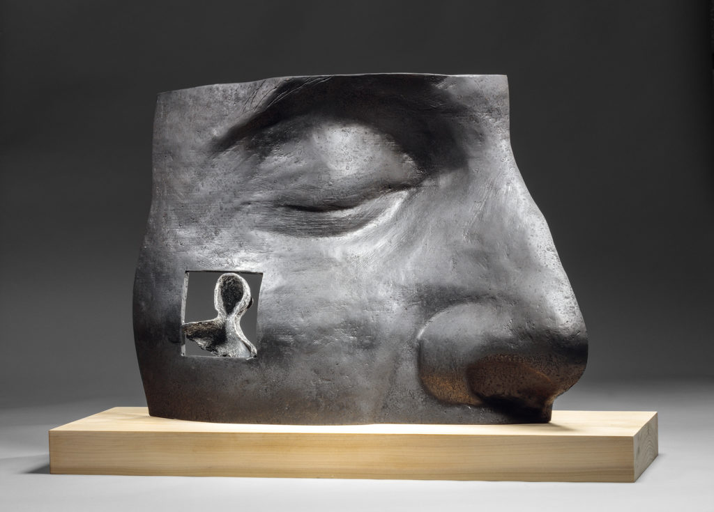 "Michael Warrick's 2018 wood and bronze sculpture, ""His Memory."""