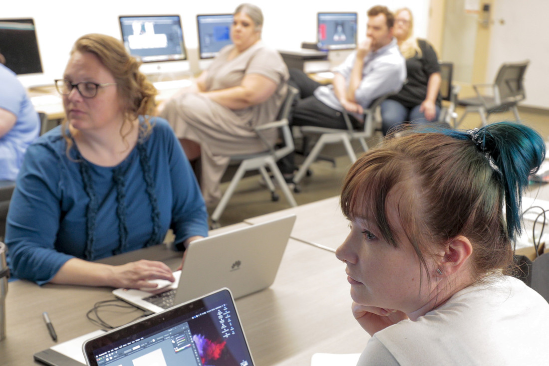 Art educators from around the state participate in a free professional development summer workshop for graphic design at UA Little Rock. Photo by Ben Krain.