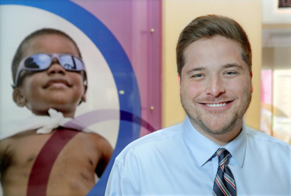 Bowen law student Caleb Conrad is working a summer internship at Arkansas Children's Hospital with the Medical-Legal Partnership offering legal aid to patients and their families. Photo by Ben Krain.