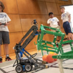 Teams of students in grades 3-8 prepare their robots to compete in the filed challenge in the VEX IQ Advanced Robotics Camp. Photo by Ben Krain.