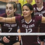 UA Little Rock volleyball players get ready for a block.