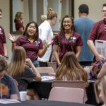 Orientation leaders help incoming students during a freshman orientation session.
