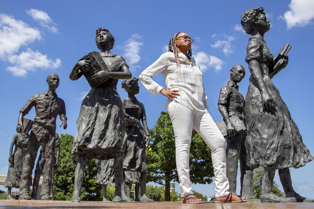 UA Little Rock graduate student Nancy Hall will stands among statue of the Little Rock Nine memorial at the State Capitol. Photo by Ben Krain.