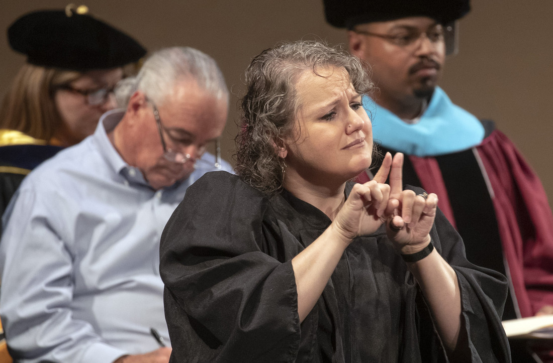 Sign language interpreter Gwenyth Sutphin translates during a freshmen convocation event.
