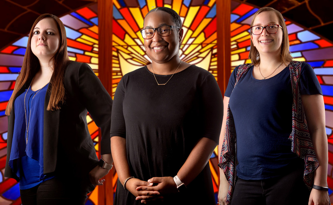 From left, UA Little Rock students Jessica Olson, Jasmine Pugh, and Kaylyn Hager are researching how partnerships between churches and nonprofit organizations can provide services to the community. Photo by Ben Krain.