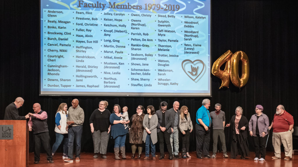 Northrup and Schmeckenbecher celebrate the 56 faculty members who have contributed to the UA Little Rock Interpretation Education Program since 1979. Photo by Brad Simms.