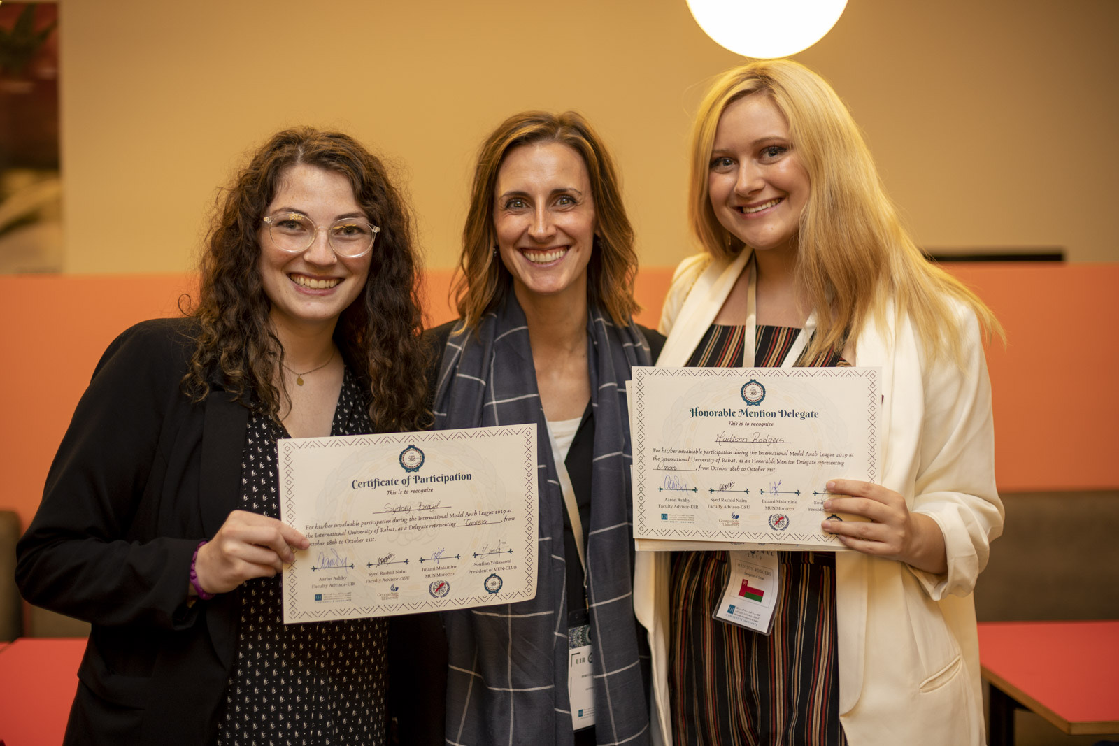 Model Arab League Advisor Rebecca Glazier (middle) poses with Sydney Brazil (left) and Madison Rogers (right), who won awards at the International Model Arab League in Morocco.