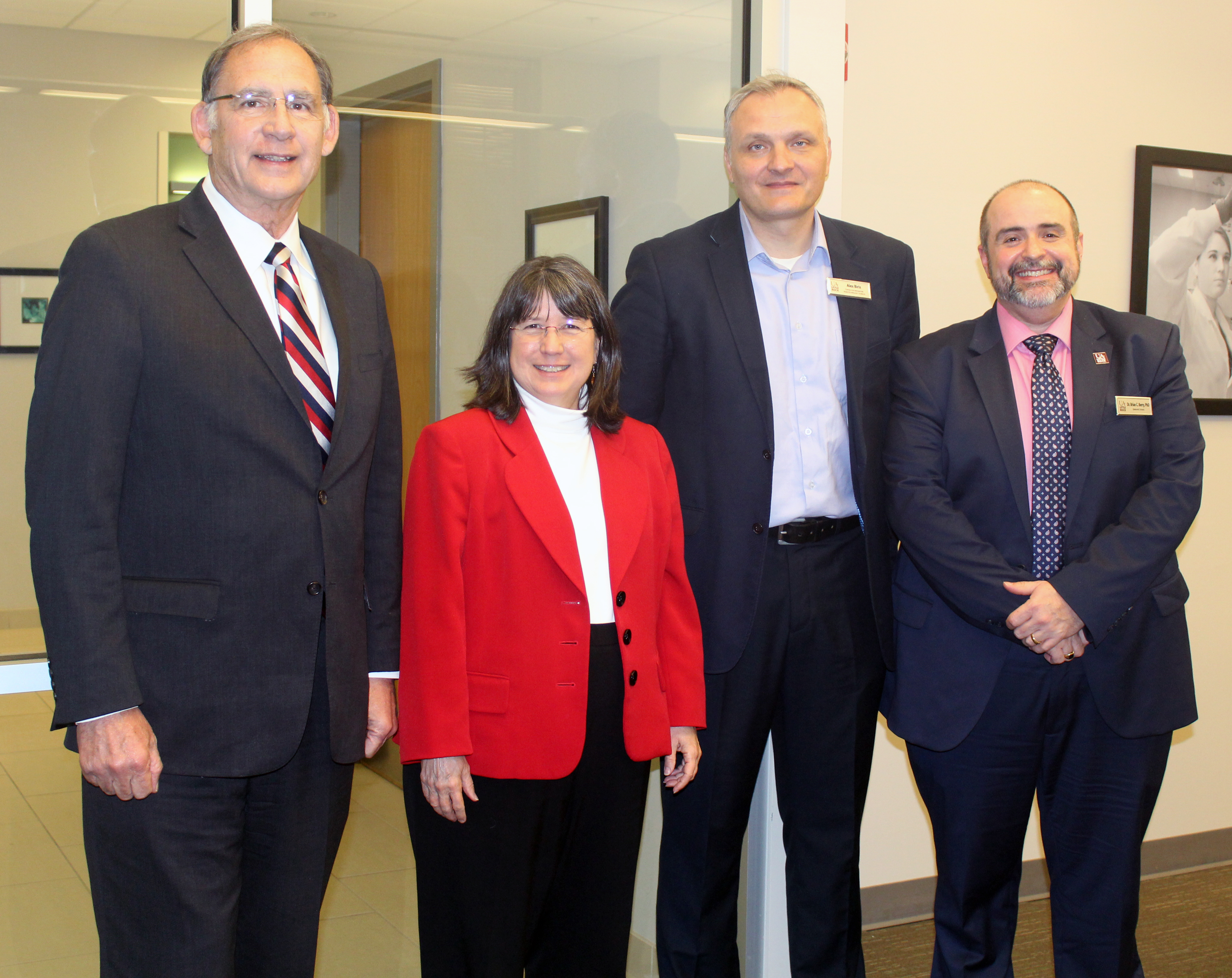 Sen. John Boozman (left) visits with Chancellor Christina Drale, Dr. Alex Biris, and Dr. Brian Berry during a research visit at UA Little Rock.