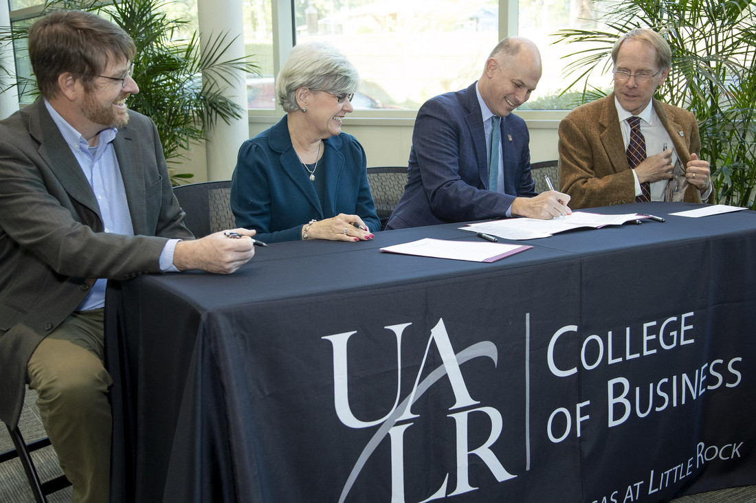 UA Little College of Business students, faculty and staff participate in a Real Estate Scholarship Signing Ceremony with members of the Arkansas Real Estate Foundation Board to establish a scholarship benefiting the Department of Economics and Finance.