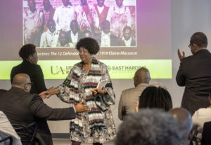 Sheila Walker thanks Dr. Brian Mitchell while being honored as a descendant of the Elaine 12. Photo by Ben Krain.