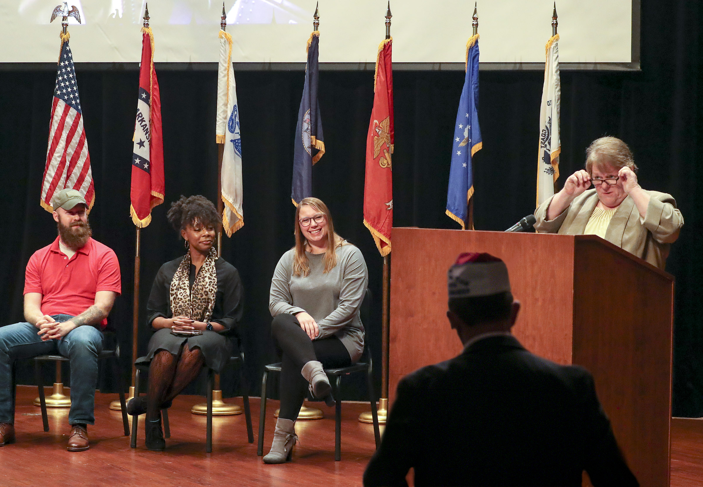 Kathy Oliverio right, honors UA Little Rock student veterans, from left, Sean Lewis, Alexis Harris, and Kaycee Greenwood, who participated in a Veterans Day ceremony. Photo by Ben Krain.
