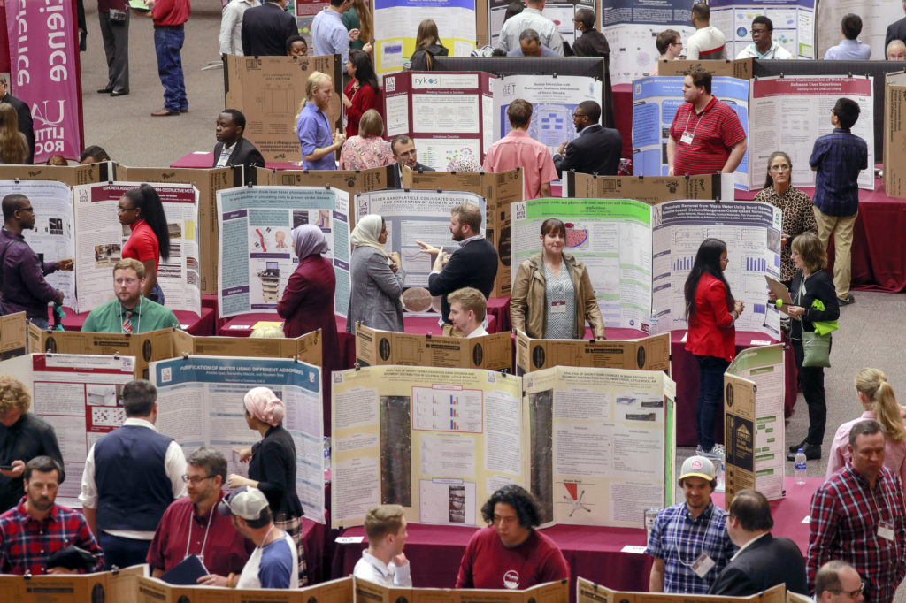 Students present their research projects during the Research and Creative Works event.