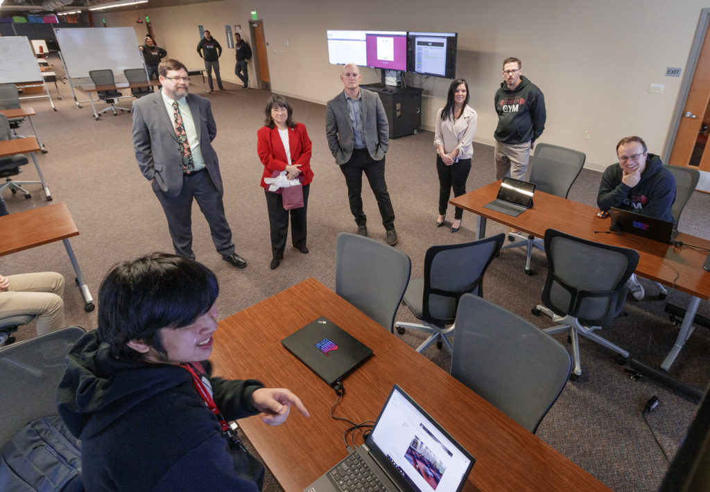 UA Little Rock visitors tour the UA Little Rock Cyber Gym, which opened in December 2019. Photo by Ben Krain.